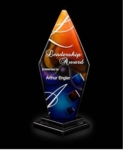 10.5 Trilogy Pillar Award Multi-colored slumped art glass Pillar with a two-tier black glass base.  One imprint position and one color included. New item!Call 800-830-3386 to buy now!