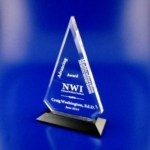 "Acrylic Triangle on Black or Walnut BaseClear Acrylic Diamond on Ebony or Walnut Wood Base. Honor extraordinary achievement with this extraordinary laser engraved award of classic design.The 10"" size of this award has beveled edges. The 8 size does not have the beveled edges. Call 800-830-3386 to buy now!"