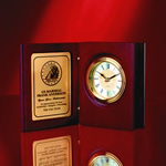 "Very Elegant Hinged Award or Gift in presentation Book Form. This 5 ½"" Book Clock with Hand-rubbed Rosewood finish displays timeless beauty and is ideal for commemorating superior accomplishments and milestones. Brass inlayed engraving plate is ideal for communicating warm sentiments.Additional Charges For Engraving and Logos"