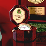 "Elegant Solid Rosewood Octagonal Box ""Captains Clock features Gleaming Brass Tilting Alarm Clock and Richly Engraved Brass Plate inside Hinged Lid. A Timeless Keepsake that sits 4 high when closed.Additional Charges For Engraving and Logos"