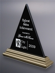 Jet black marble with a lustrous, platinum-finished wood framing striking awards in timeless designs. The peak of the pyramid is a highly desired award as a symbol of success. This glorious piece can be screen printed or deep etched and color filled.Set-up and Etching Charge $50Additional Units $25